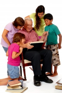 grandkids looking at photos with grandpa